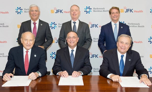 The board of JFK and Hackensack Meridian sign the merger agreement.