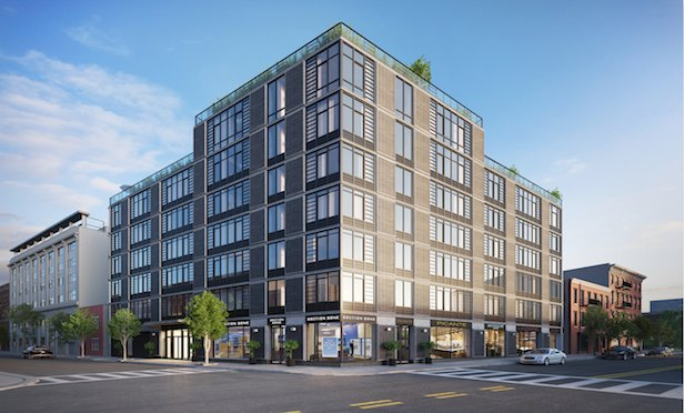 The more than 8,700-square-foot retail space sits at the base of a new 50-unit luxury residential condominium development.