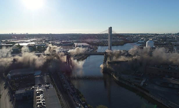 The implosion of the Kosciuszko Bridge completed the $555-million first phase of the bridge replacement project.