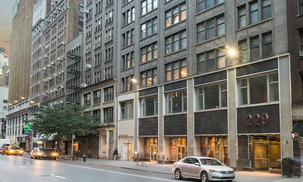 Investcorp-Brickman Partner on Garment District Buy