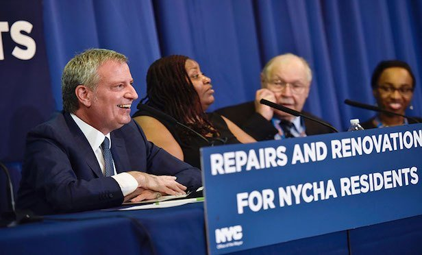 New York City Mayor Bill de Blasio (far left) announced the NYCHA repair programs at a press conference held at the Campos Plaza I-apartment complex on the Lower East Side.