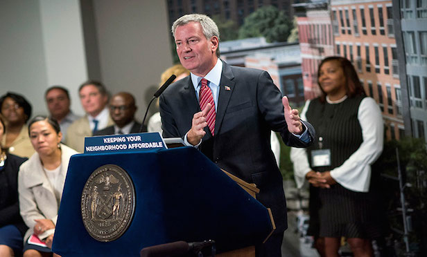 "New York City Mayor Bill de Blasio said that while the 400,000 New York City public housing residents will see improvements each year, to address the totality of the problems detailed in the consent decree ""will take a long time and a huge amount of resources."""