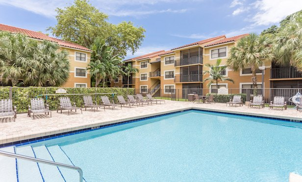 """The 316-unit Park Colony Apartments complex will be renamed """"The Env"""" by new ownership."""