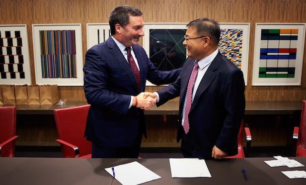 Avison Young CEO Mark Rose (left) welcomes Byoung Gon Choi, CEO of Mate Plus Advisors, to Avison Young.