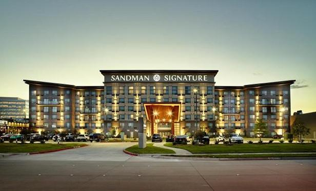 The exterior of the Sandman Signature Plano – Frisco Hotel in Plano, TX.