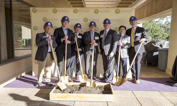 Representatives from SF State, American Campus Communities and the project team celebrate the commencement of construction of the university's newest on-campus student housing.