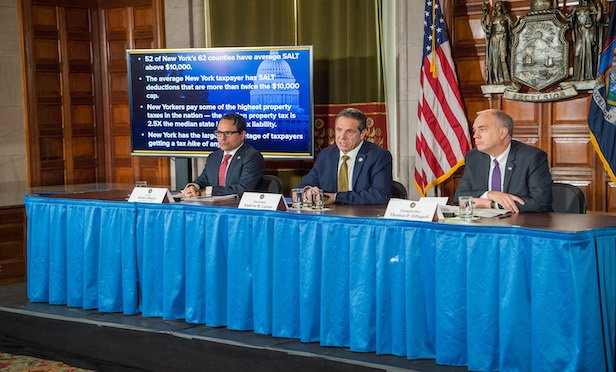 From left at the press conference in Albany are: State Budget Director Robert Mujica, Gov. Andrew Cuomo and State Comptroller Thomas P. DiNapoli.
