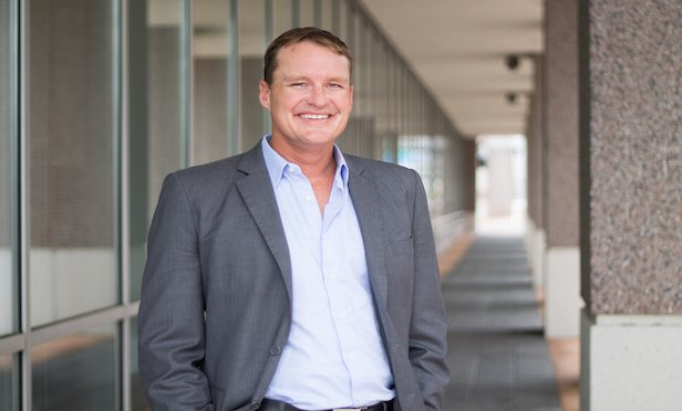 Greg Main-Baillie, managing director of the development services division, Colliers International Florida