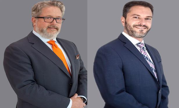 From left, Quinn Gormley, executive vice president, HTG America and Max Cruz, executive vice president