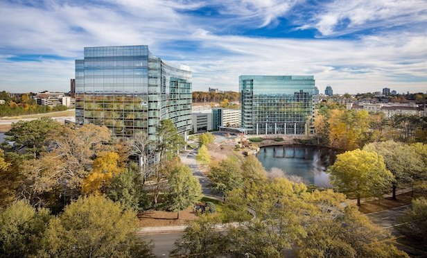 Columbia Property Trust has sold One and Three Glenlake, a 711,000-square-foot office campus in Atlanta, for $227.5 million. Photo credit: APG Photography