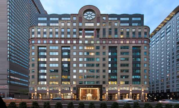 The 272,000-square-foot 116 Huntington Avenue office building in the Back Bay of Boston is now 100% leased. Photo by Chuck Choi Architectural Photography.