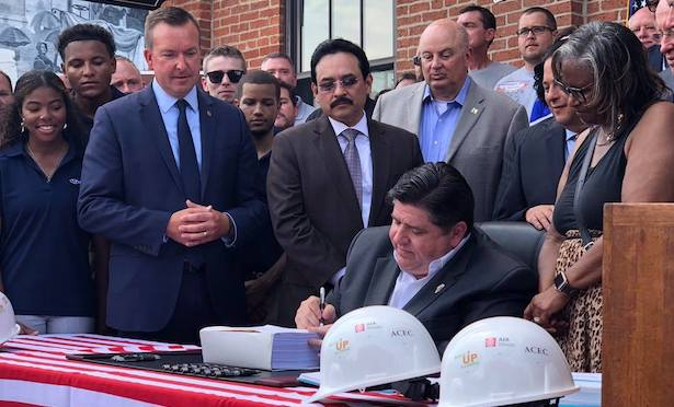 "Gov. J.B. Pritzker signed the ""Rebuild Illinois"" package of bills into law on Friday."