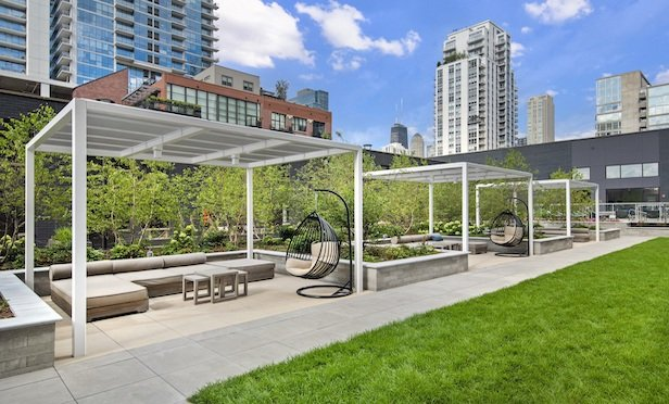 """The """"rooftop oasis"""" at River North Park features a variety of seating options including shaded cabana spaces."""
