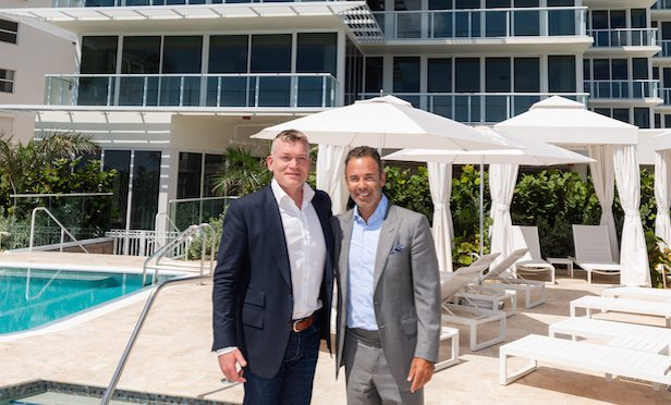 From left, Joseph A. McMillan, Jr., chairman and CEO, DDG and Jay Phillip Parker, CEO, Douglas Elliman Florida Brokerage. Photo Credit: DDG