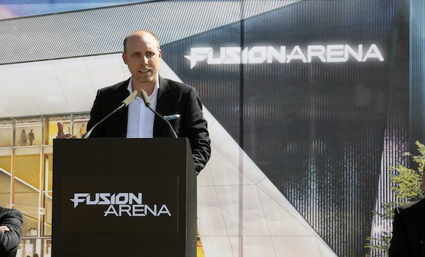 Brian Mirakian, senior principal at architectural firm Populous, addresses the crowd at the Fusion Arena groundbreaking ceremony in Philadelphia.