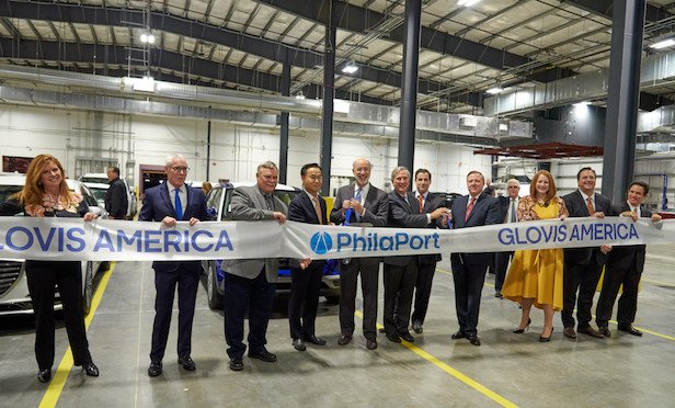 At the ribbon cutting ceremony were from left: Lisa Magee, director of engineering, PhilaPort; Jeff Theobald, executive director and CEO, PhilaPort; Jimmy Durr, general manager, Glovis America; JinWoo Jeong, president and CEO, Glovis; Governor of Pennsylvania, Tom Wolf; Jerry Sweeney, PhilaPort Board Chairman; Pennsylvania State Senator Larry Farnese; Scott Cornell, COO, Glovis America; Jennie Granger, Deputy Secretary, PennDot; Glenn Clift, advisor, Glovis America; Charles Gallub, president, DVR.
