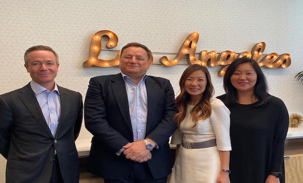 From left, Cushman & Wakefield's West Region president Andrew McDonald, C&W's Global president John Forrester, ASPIRE co-chair Hanna Kim Yoon and ASPIRE co-chair Annie Canada.