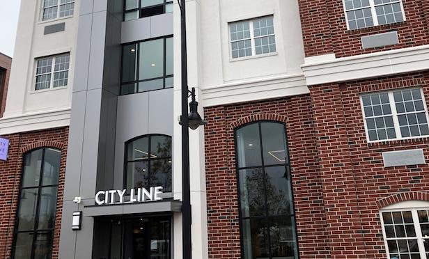Exterior of the City Line West 144-unit luxury apartment complex.