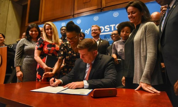 Boston Mayor Martin J. Walsh signs the cannabis regulation bill into law.