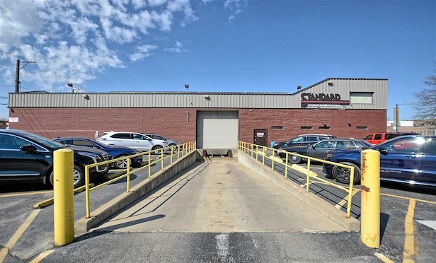 The property acquired by Realterm Logistics features four brick buildings totaling 43,828 square feet and a large lot used for truck and trailer parking. It has served as Standard Equipment's headquarters since 1986.