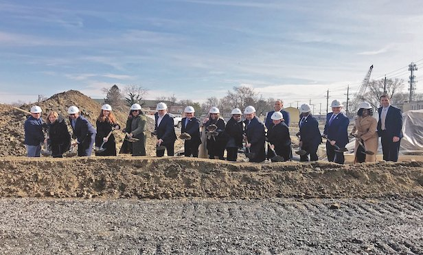 Officials with the New Jersey Housing and Mortgage Finance Agency and developer The Michaels Organization participate at the groundbreaking event for the final phase of The Branches at Centerville. Photo Courtesy of The Michaels Organization.