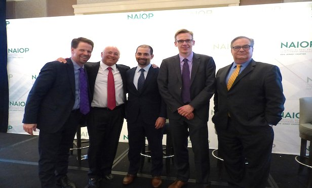 From left, panel moderator Tom Bergeron, Editor, ROI-NJ; Andrew Merin, executive vice chairman, Cushman & Wakefield; Ed Russo, CEO, Russo Development; Alexander Heil, chief economist, Port Authority of New York & New Jersey and Chris Paladino, president, DEVCO