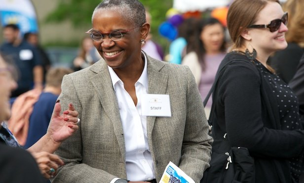 Tracey Scott currently serves as the interim executive Director and CEO for the Minneapolis Public Housing Authority.