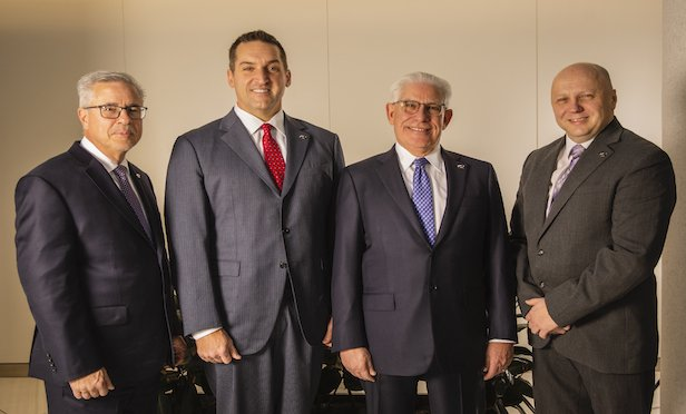 From left, Maser Consulting COO Joseph A. Dopico; CEO/President Kevin L. Haney; Executive Chairman, Richard M. Maser; and Executive VP/CAO, Leonardo E. Ponzio.