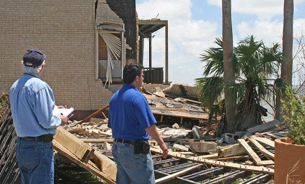 Representatives from FEMA and the U.S. Small Business Administration document damages to a multifamily property on South Padre Island following Hurricane Dolly, a Category 2 hurricane that struck the island with more than 100 mile an hour winds.