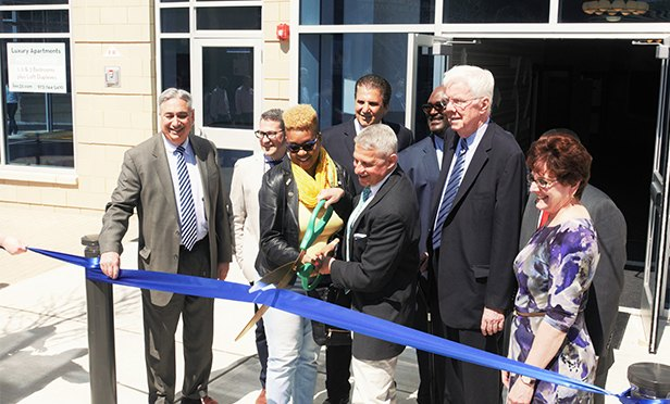 Officials cut the ribbon at Linc at Orange Station. From left: Anthony Marchetta, Executive Director of HMFA; Joaquin Bouzas, Principal at Inglese Engineering and Architecture; Donna Williams, Councilmember-At-Large & Council President for the City of Orange; Joseph N. DiVincenzo, Jr., Essex County Executive; Edward Martoglio, President of RPM Development; Marty Mayes, Director of Planning & Development and the Department of Public Works; Thomas P Giblin, Assemblyman of District 34; Dr. Lanel D. Guyton, Pastor of St. Matthew A.M.E. Church; Marie Mascherin, Chief Lending Officer of NJ Community Capital