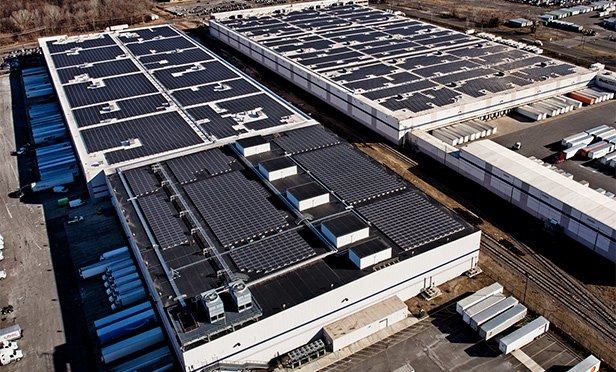 Amazon fulfillment center, with solar panels on roof