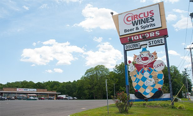 """Iconic """"Calico the Clown"""" sign has marked the Route 35 property for decades. (Steve Lubetkin photo/StateBroadcastNews.com)"""