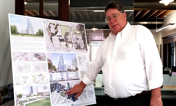George Kimmerle, founder, president, and partner of Kimmerle Group, discusses a design plan in his firm's Harding Township, NJ office. (Steve Lubetkin photo/StateBroadcastNews.com)