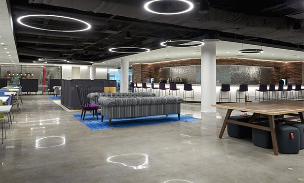 The Lab, a common space in the remodeled 56 at Roseland, Roseland, NJ,  is a collaborative space to promote interaction among the Lowenstein Sandler law firm's team.