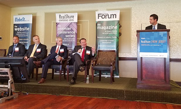The industry outlook panel at Tuesday's RealShare New Jersey conference. From left: Jeffrey Steigerwalt, vice president and commercial lender, Real Estate, ESSA Bank & Trust; Ken Spahn, regional director, Ports and Intermodal, Dewberry, a private engineering and consulting firm; James Morris, administrative vice president, Commercial Real Estate/Group Manager, M&T Bank; Fred Schmidt, president and COO, Coldwell Banker Commercial; and at the lectern, moderator Brian Whitmer, executive director, Cushman & Wakefield