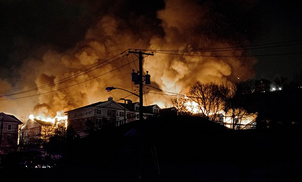 The 2015 fire that destroyed a large portion of Avalon at Edgewater is a major impetus for the movement to tighten building construction safety codes. (Steven Brener photo from Flickr.com under Creative Commons license)