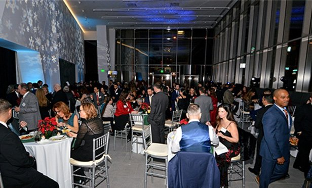 IMC announced its Center City office at a holiday party at celebrated the holidays at Penn Medicine's newly constructed Center for Healthcare Technology building