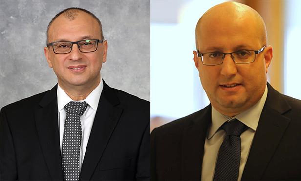 Moshe Lachmani, CEO, left, and Tamir Cohen, chairman of the board of Shikun & Binui