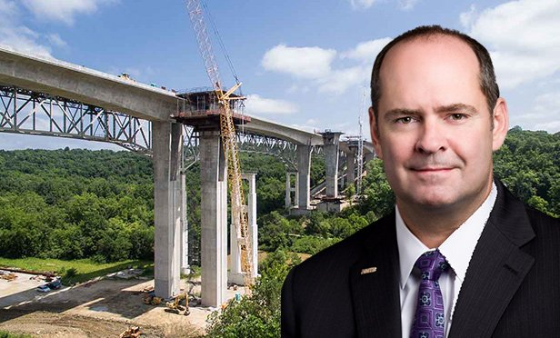 Rob Slimp, chairman, president and CEO of HNTB, Kansas City, MO, with one of the firm's projects, the Jeremiah Morrow Bridge, Warren County, OH