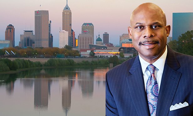Warren Thompson, chair and president, Thompson Hospitality, with Indianapolis skyline (skyline photo by Serge Melki, Creative Commons License via Flickr.com)