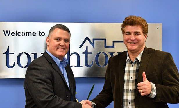Jeff Hiscox, chief executive officer of Uniguest (left) and Ted Teele, chief executive officer of Touchtown
