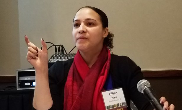 Lillian A. Plata, founding member of Nee Plata Law, discusses opportunity zone regulations at the New Jersey Future Redevelopment Forum in New Brunswick, NJ (Steve Lubetkin Photo/State Broadcast News)