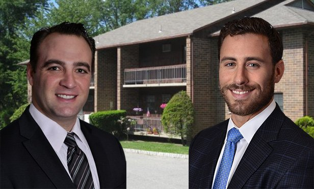 Adam Zweibel, senior vice president, left, and Stephen Tragash, executive vice president, Gebroe-Hammer Associates, with Landmark West garden apartments, Newton, NJ