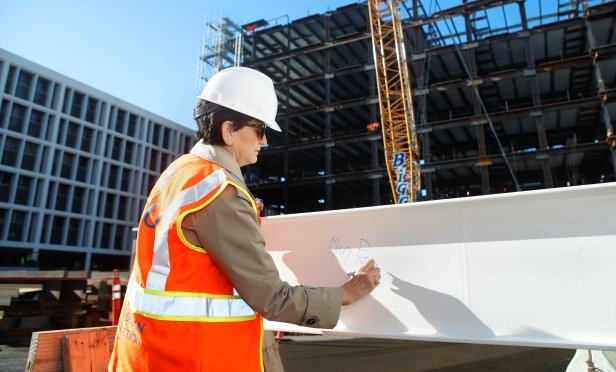 President Papazian signs one of the beams that will be used to top out the Interdisciplinary Science Building, the first new academic building at SJSU in more than 30 years. At San Jose State University in San Jose/