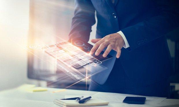 Businessman using tablet for digital marketing. (Photo: PopTika/Shutterstock.com)