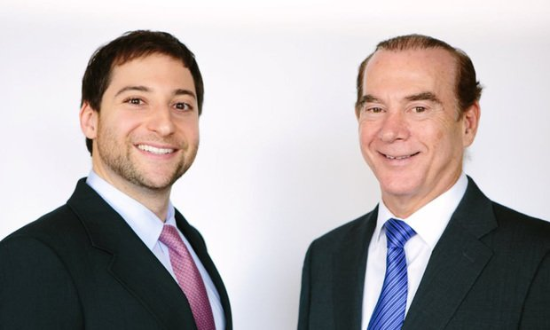 Charles Penan, left, executive vice president and Howard Taft, right, senior managing director with Aztec Group.