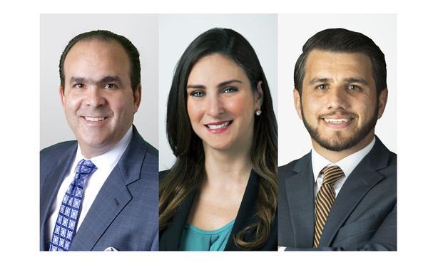 Holland & Knight partners Alberto Hernandez, Elena Otero, and associate Faisal Kraziem in Miami.