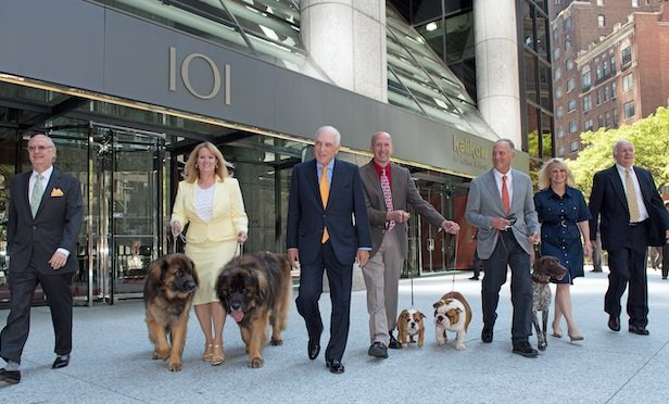 Peter Kalikow (center), with AKC leadership and award-winning dog owners.