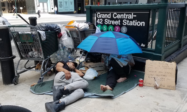 Homeless people at the MTA Grand Central Terminal entrance/ Photo by Betsy Kim