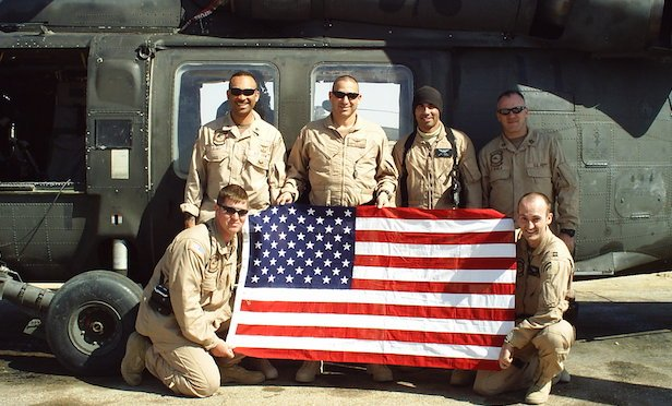 Left to right: crew chief sergeant Neil MacArthur, senior crew chief instructor, staff sergeant Fred Derry, LTC Robert Vicci (Vandal 6) - battalion commander, crew chief sergeant Jose Miranda, platoon sergeant first class Bill O'Hara, and company commander, (Hooligan 6) captain Joe Roughneen. (Baghdad, Iraq, March 20, 2005)
